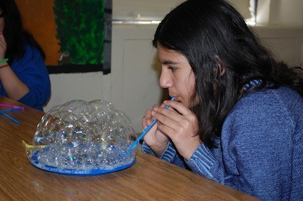 Salwa Zahid learned how to make bubbles in the science enrichment course at the James A. Dever School.