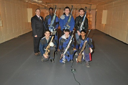The varsity shooters for the Valley Stream Central High School District rifle team, joined by coach Vito Genova, are Neil Aliventi, Jurell Wilson, Kristen Mantell, Tom Steffens, Safraz Bacchus and Sean Biegler.