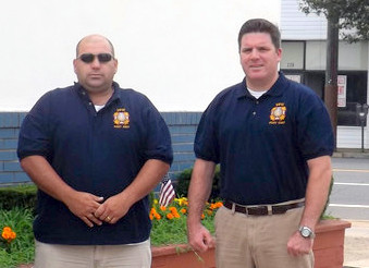 "Kevin Canty, right, commander of the VFW post in Lynbrook, told the school board that its ""no"" vote tarnished the image of the village's motto: ""Lynbrook USA."" Ex-commander Pat Cardone, left, wanted more involvement in the process."