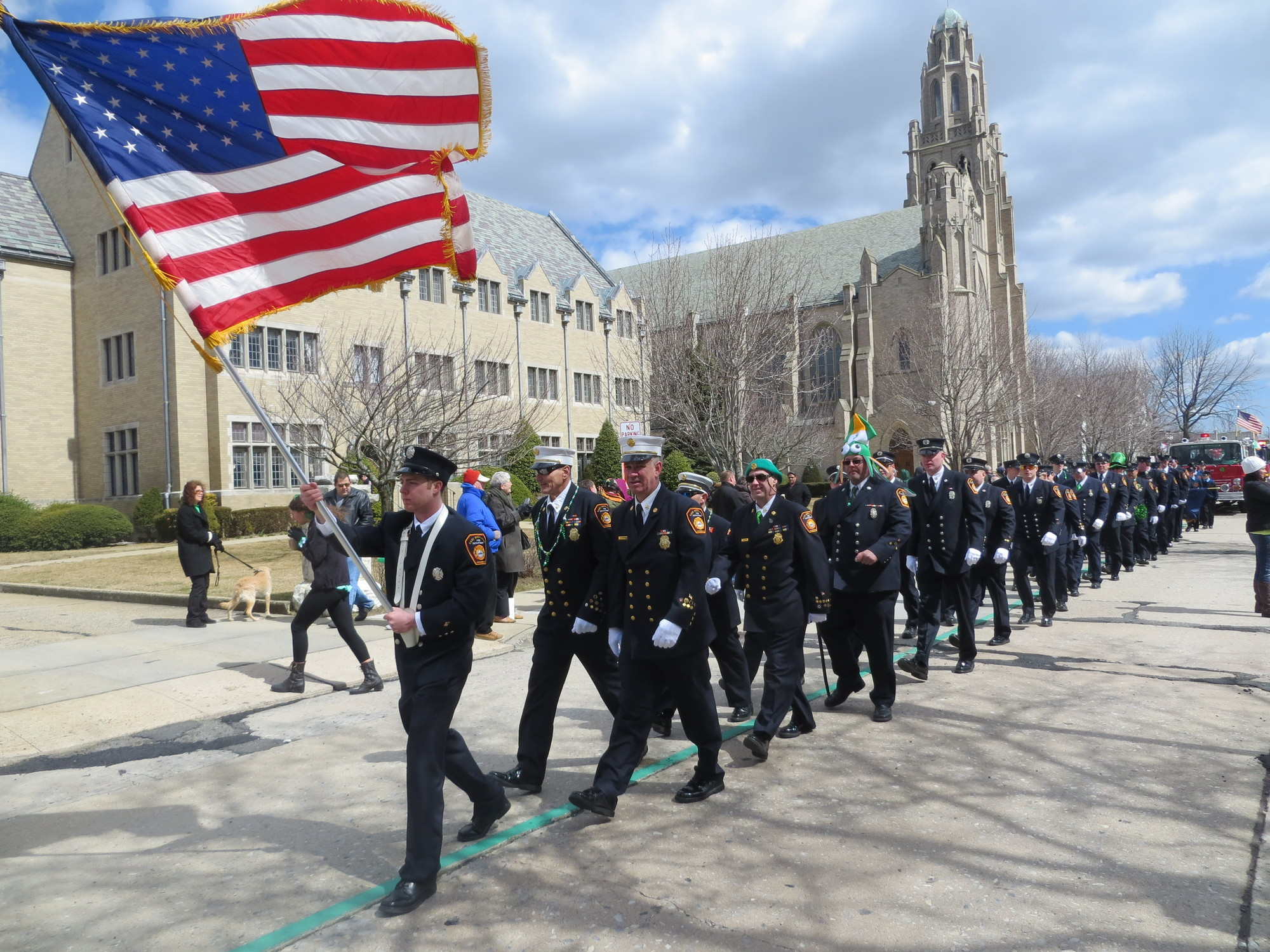Local fire departments marched past St. Agnes Cathedal in last year's parade.