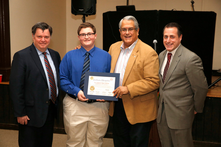 Lynbrook Junior Fire Department Ex-Captain Ryan Kenny was presented with a Certificates of Recognition Lynbrook Mayor Bill Hendrick, left, Town Councilman Anthony Santino and Assemblyman Brian Curran.