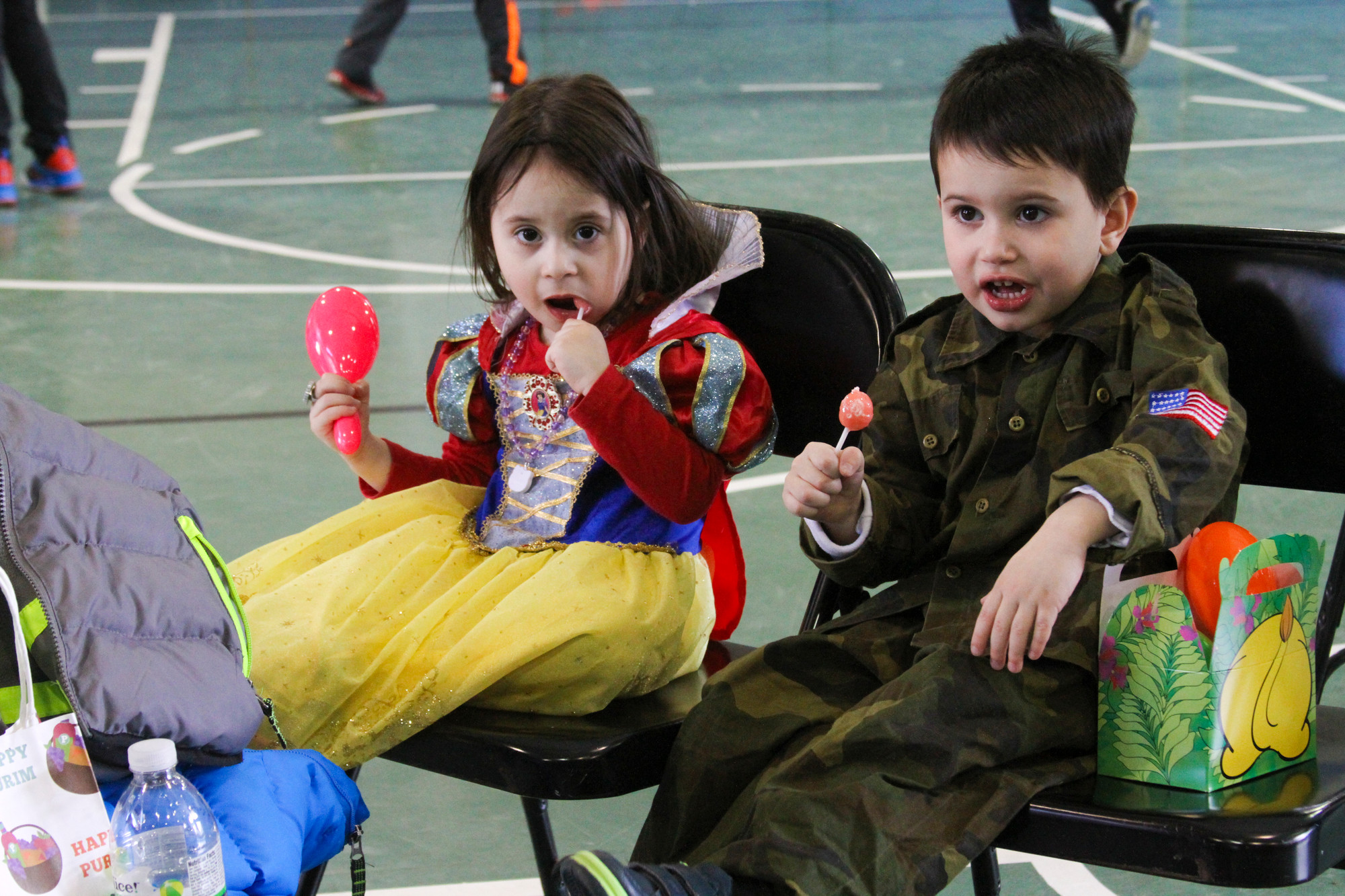 Shani, 3, and David, 4, Halimi took a break from the Purim activities.
