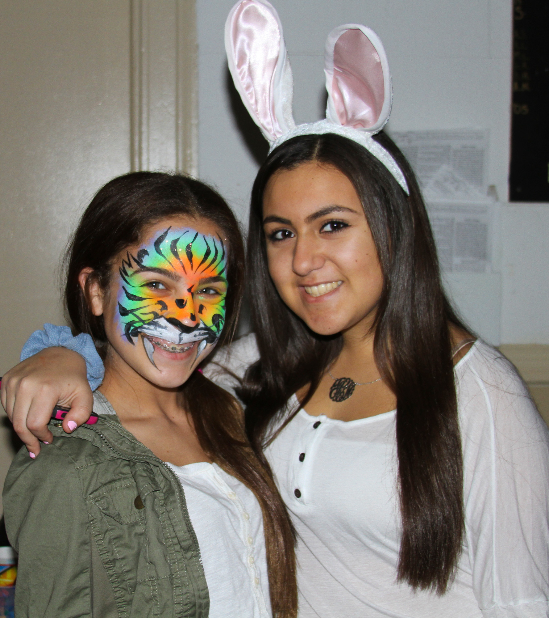 Chabad's Purim Party had an African theme. Ruby Levine, left, had her face painted as a rainbow tiger, while Jessie Cohen dressed as a more domesticated animal.