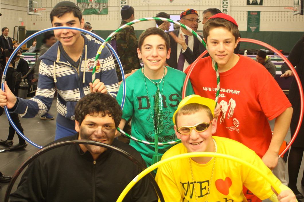 Illustrating the costume theme of the Olympics were from left standing Yehuda Benhamu, Ruvie Sturm and Yair Sterman and kneeling Jacob Goldsmith, left and Eitan Kaszovitz, all DRS sophomores.
