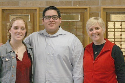 Maggie Poulos and Chris Irizarry with teacher Marla Kilfoyle.