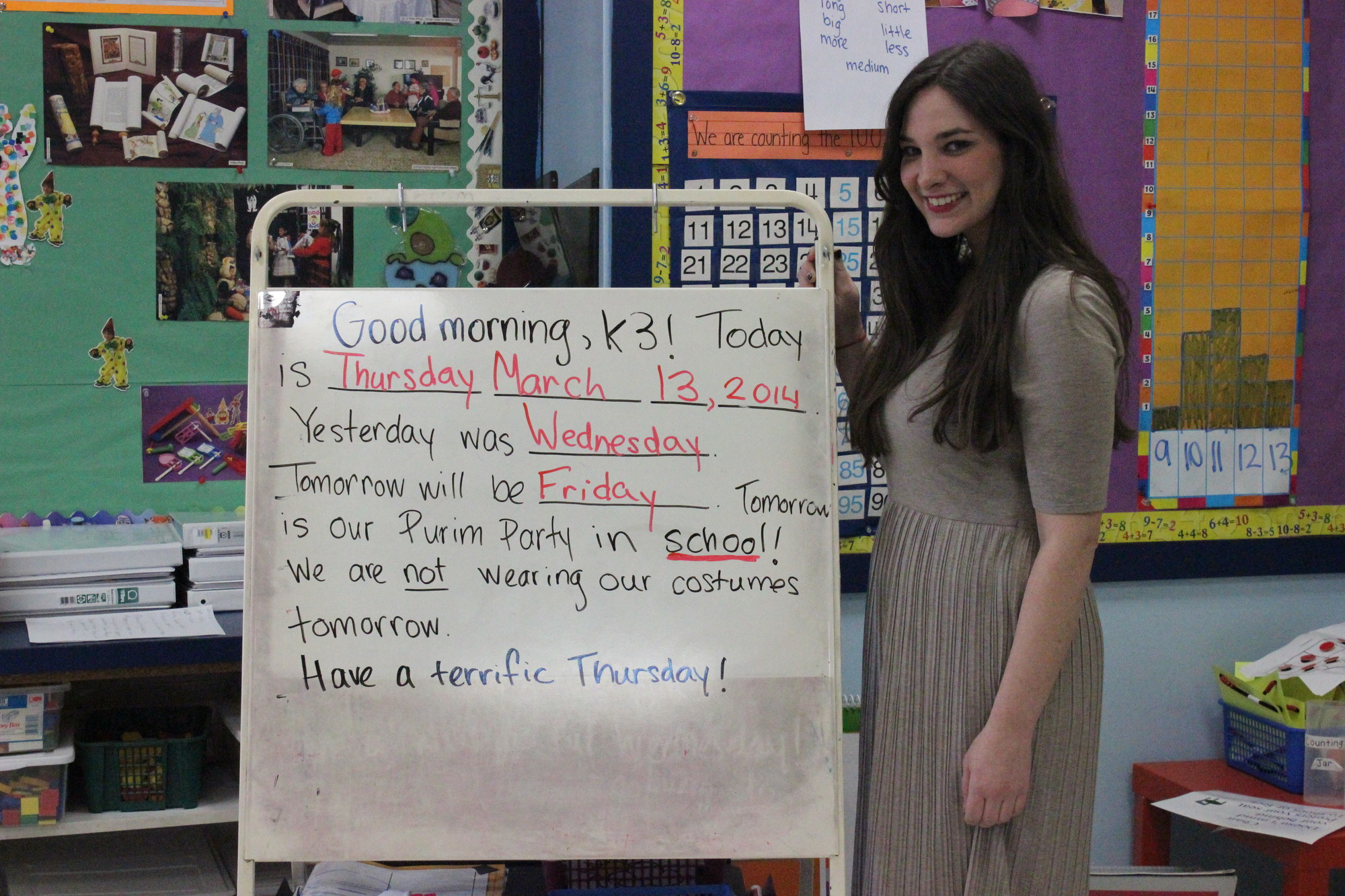 Following in her mother�s footsteps as an educator, Hannah Lippman, a HAFTR kindergarten teacher, reviewed the daily calendar in her classroom.