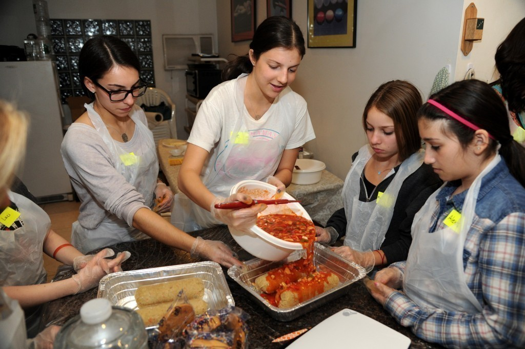 Merokean Eve Pauly, center, prepared gefilte fish with Merokean Eryn Adler, from left, and Marielle Brodman and Alexis Levien, both of Bellmore, during a recent Cooking for Hope class.
