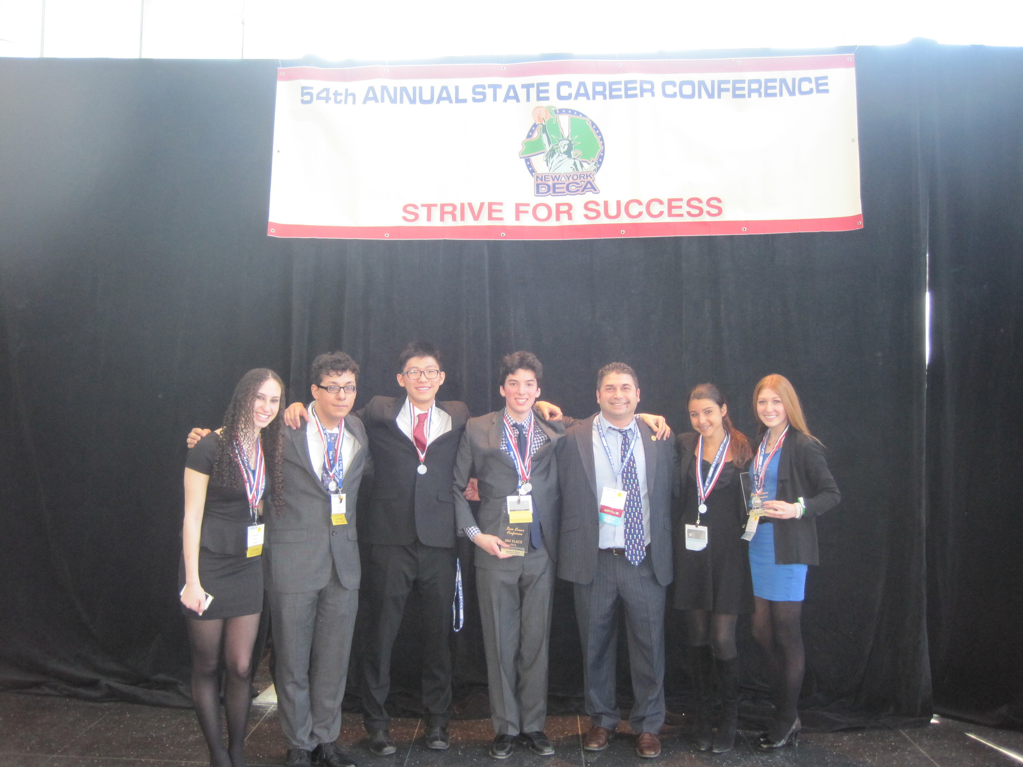 Lawrence High School students excelled at the state DECA conference. From left were students Maxine Kastriner, Thomas Lira, Ryan Bae and Jonathan Rutchik, advisor Mark Albin, and students Victoria DiCeglio and Jessica Beyer.