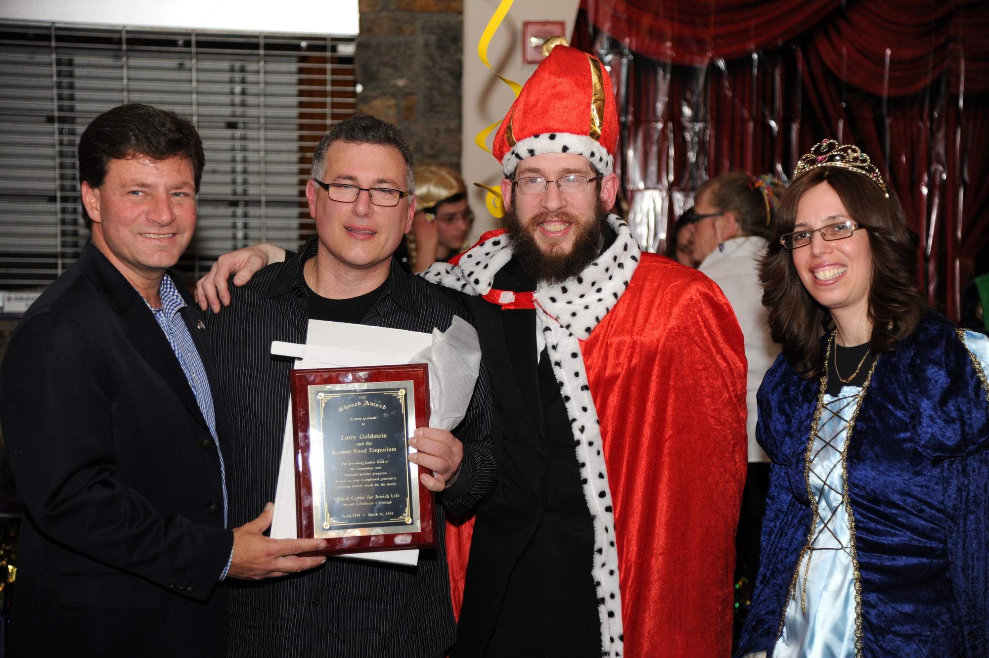 Legislator Dave Denenberg, Rabbi Shimon Kramer and Chanie Kramer presented Larry Goldstein of Plainview's Kosher Food Emporium with an award for donating food to Chabad holiday programs.