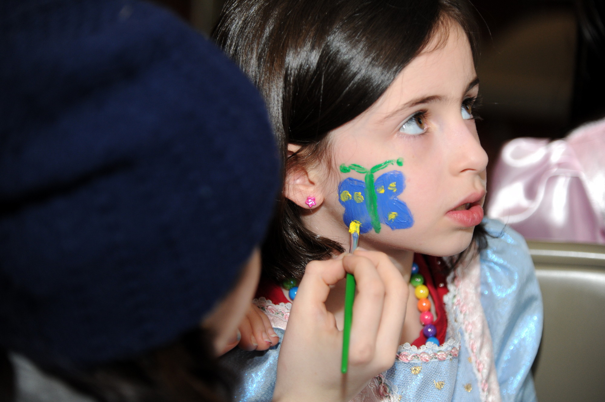 Talya Lippman, 7, had her face painted.