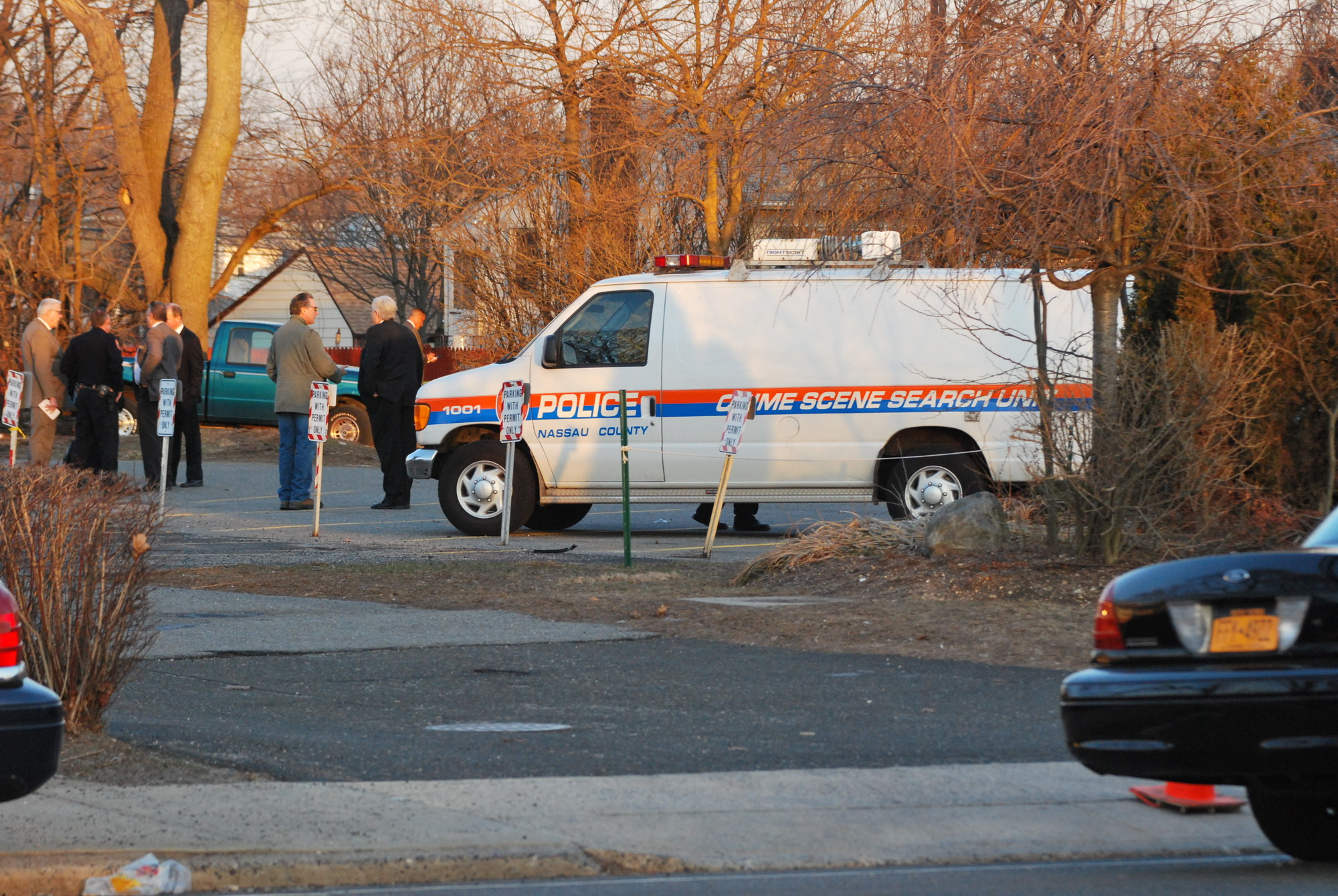 Nassau County police detectives found the body in the synagogue�s back parking lot Saturday.