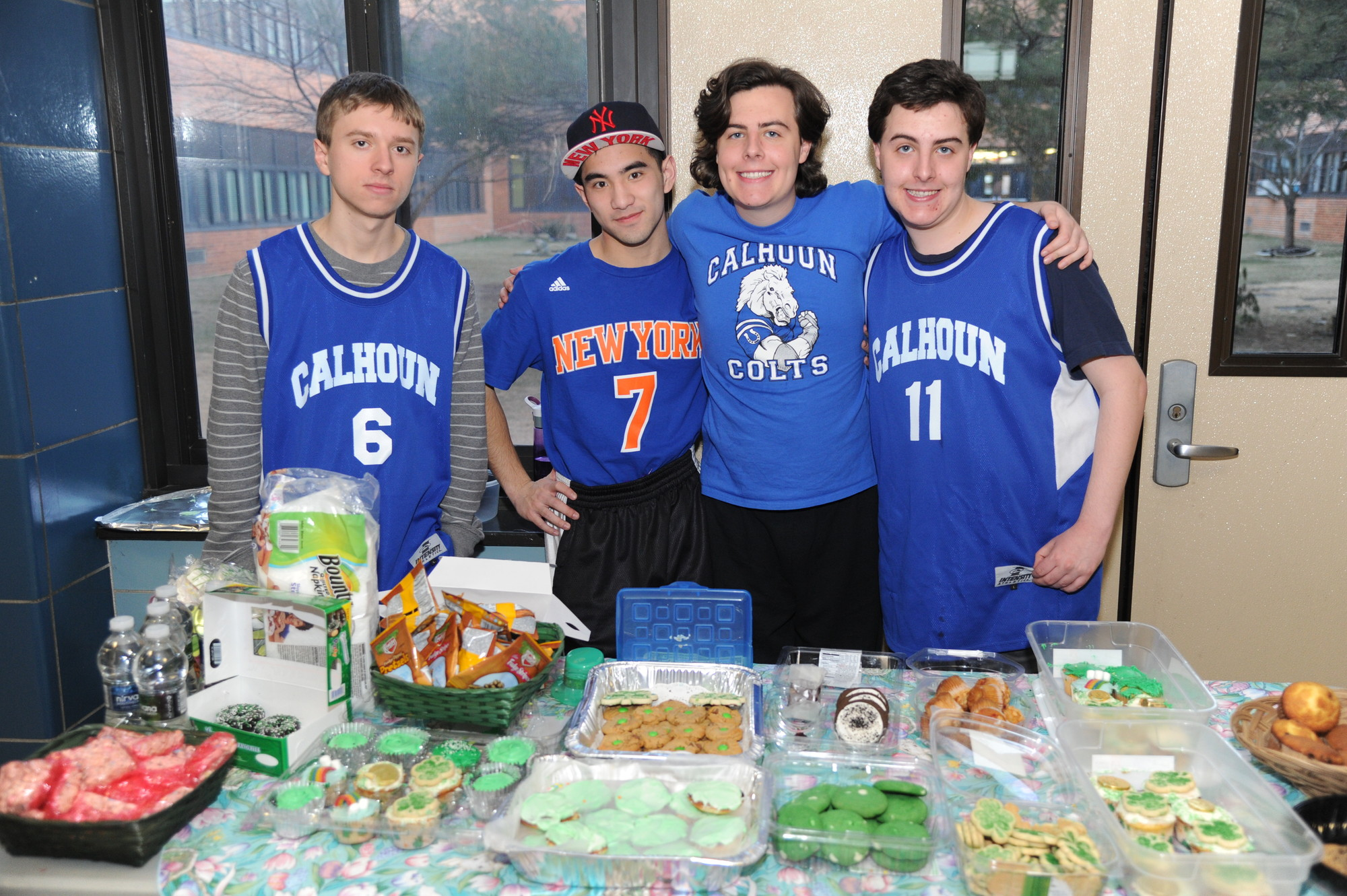 Justin Koehler, 18, Derek Ha, 21, and twins Scott and Brett Weisbrot, 16, ran the fundraiser's bake sale table.