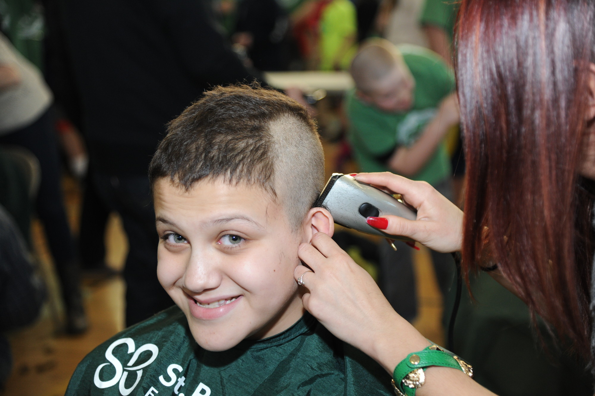 Kyle Berthoud, 13, made a $50 donation to St. Baldrick's before he had his head shaved.