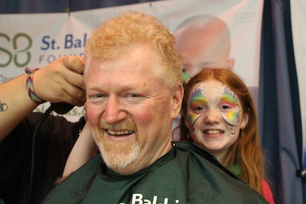 John Bender, co-founder of St. Baldrick's, got hair shaved by his daughter Casey.
