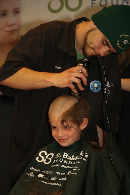 Griffin Mills, 7, a student at the Wilson School, got his head shaved by Evan Kane after raising $2,000.
