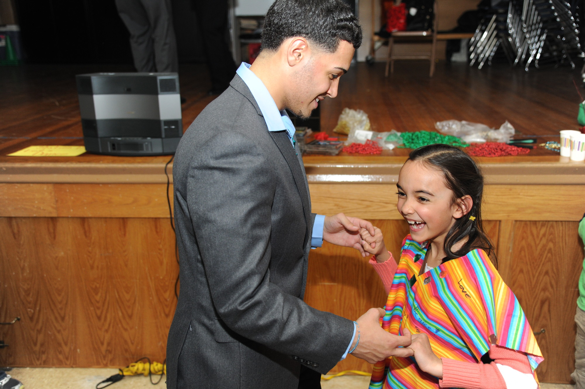 Marcus Ramirez taught Girl Scout Sevi Ozgur, 8, to salsa during his cousin Melina Ramirez's Latina Cultural Workshop at Meadowbrook Elementary School on March 28.