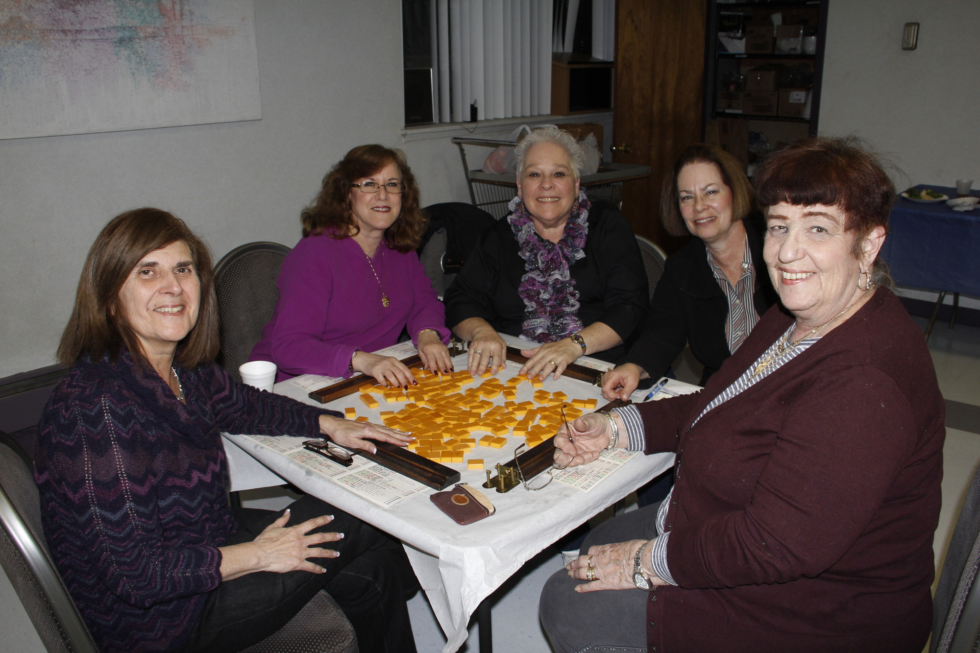 Hadassah members Libby Biemenfeld, Susan Weiss, Marilyn Gordon, Anna Cohen and Marcia Sherman play a game of maj jongg.