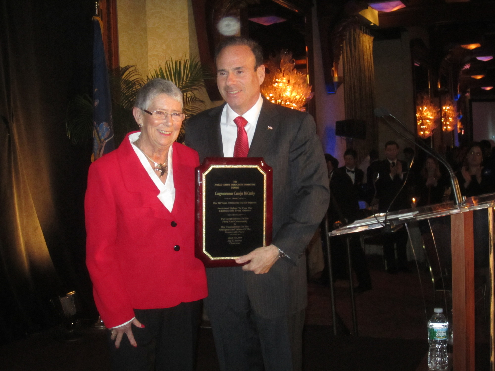 U.S. Rep. Carolyn McCarthy accepted a plaque from Jay Jacobs, the Nassau County Democratic Committee chairman, during the Nassau County Democratic Committee's annual spring dinner at the Crest Hollow Country Club on Monday.