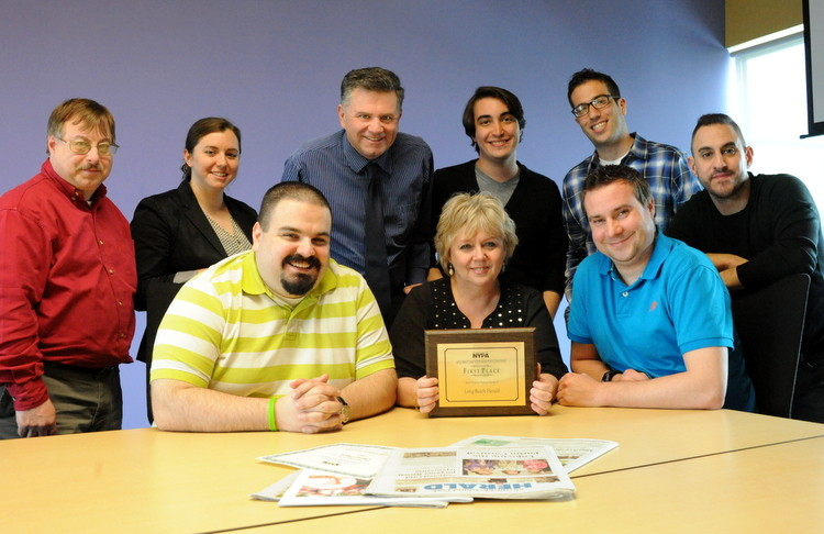 Some of the award winners included, standing, from left, Nassau Herald editor Jeff Bessen, Long Beach Herald reporter Alexandra Spychalsky, Merrick/Bellmore editor Scott Brinton, Rockville Centre reporter John Maher, East Meadow editor David Weingrad, and Long Beach editor Anthony Rifilato; and seated, from left, Rockville Centre editor Alex Costello, Lynbrook/East Rockaway editor Mary Malloy and Valley Stream editor Andrew Hackmack.