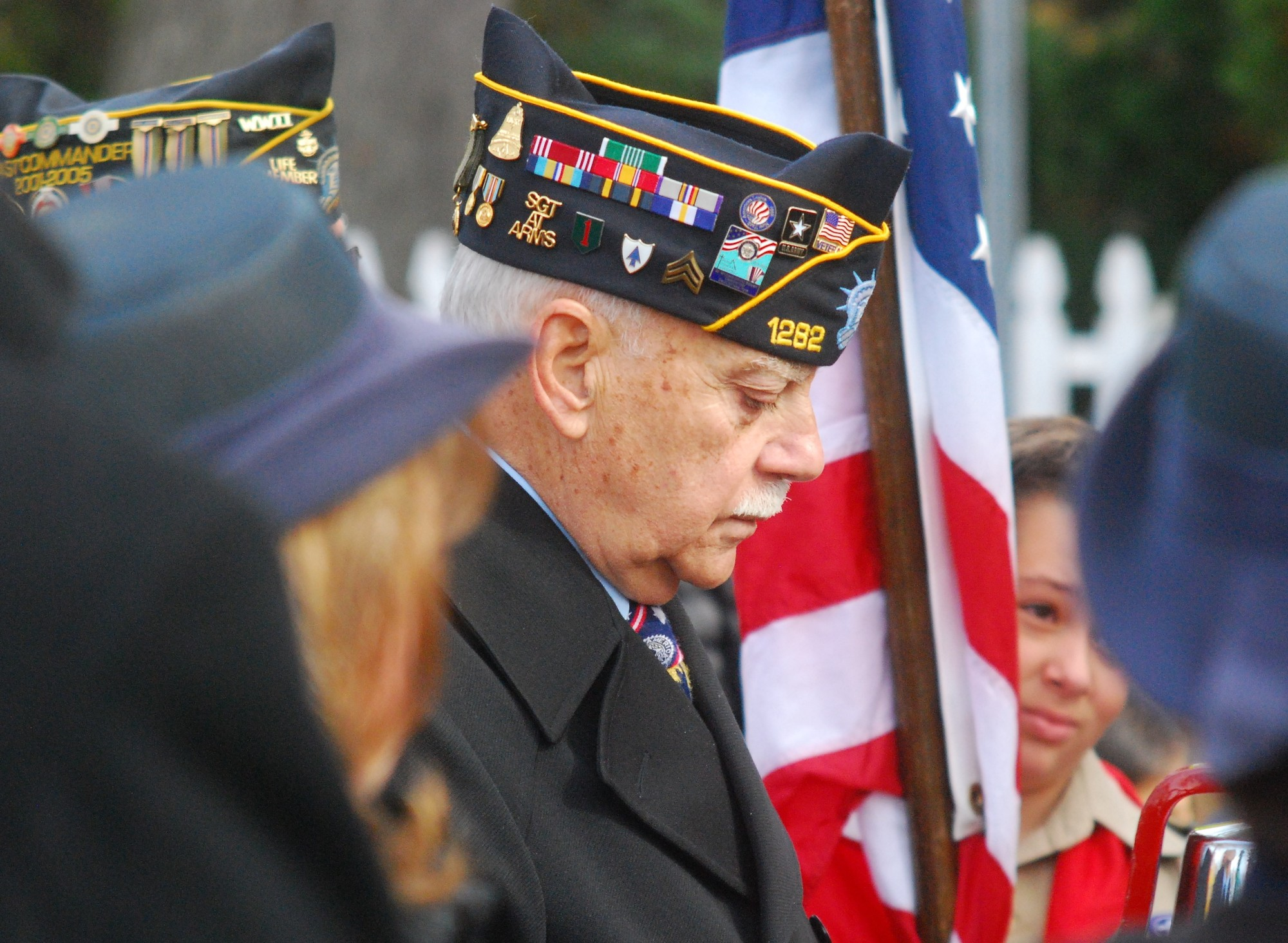 Joseph Ambrosino, Merrick American Legion Post 1282's sergeant-at-arms, observed a moment of silence during last year's Veterans Day ceremony at Veterans Memorial Park in North Merrick.