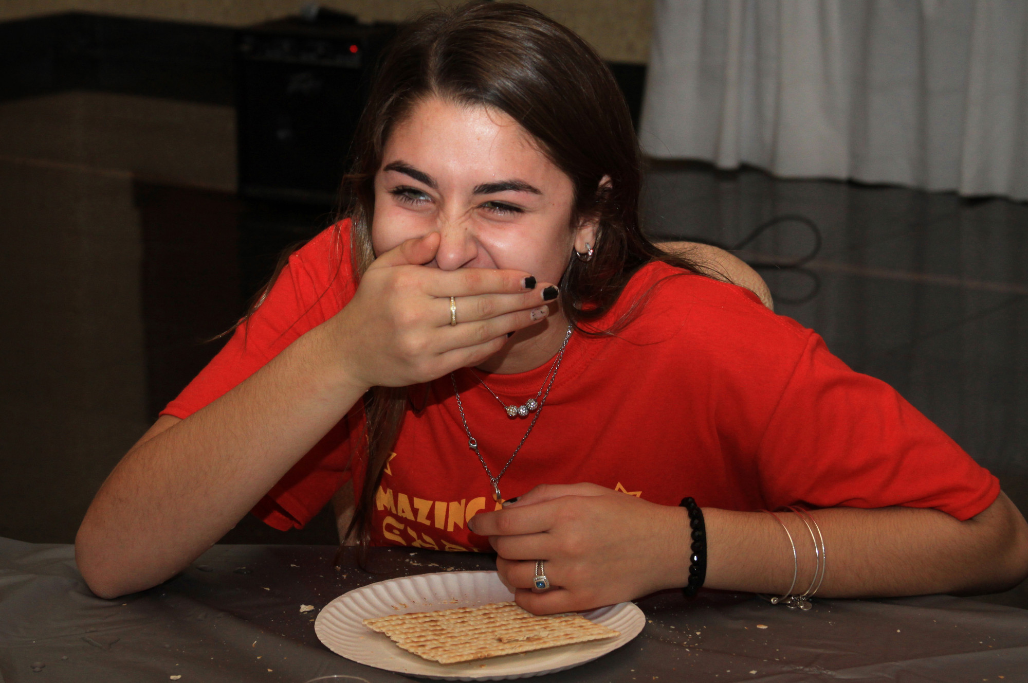 Julia Rosenberg, 13, did her best to finish two plain boards of matzah, sans water, in an eating competition near the end of the challenge.