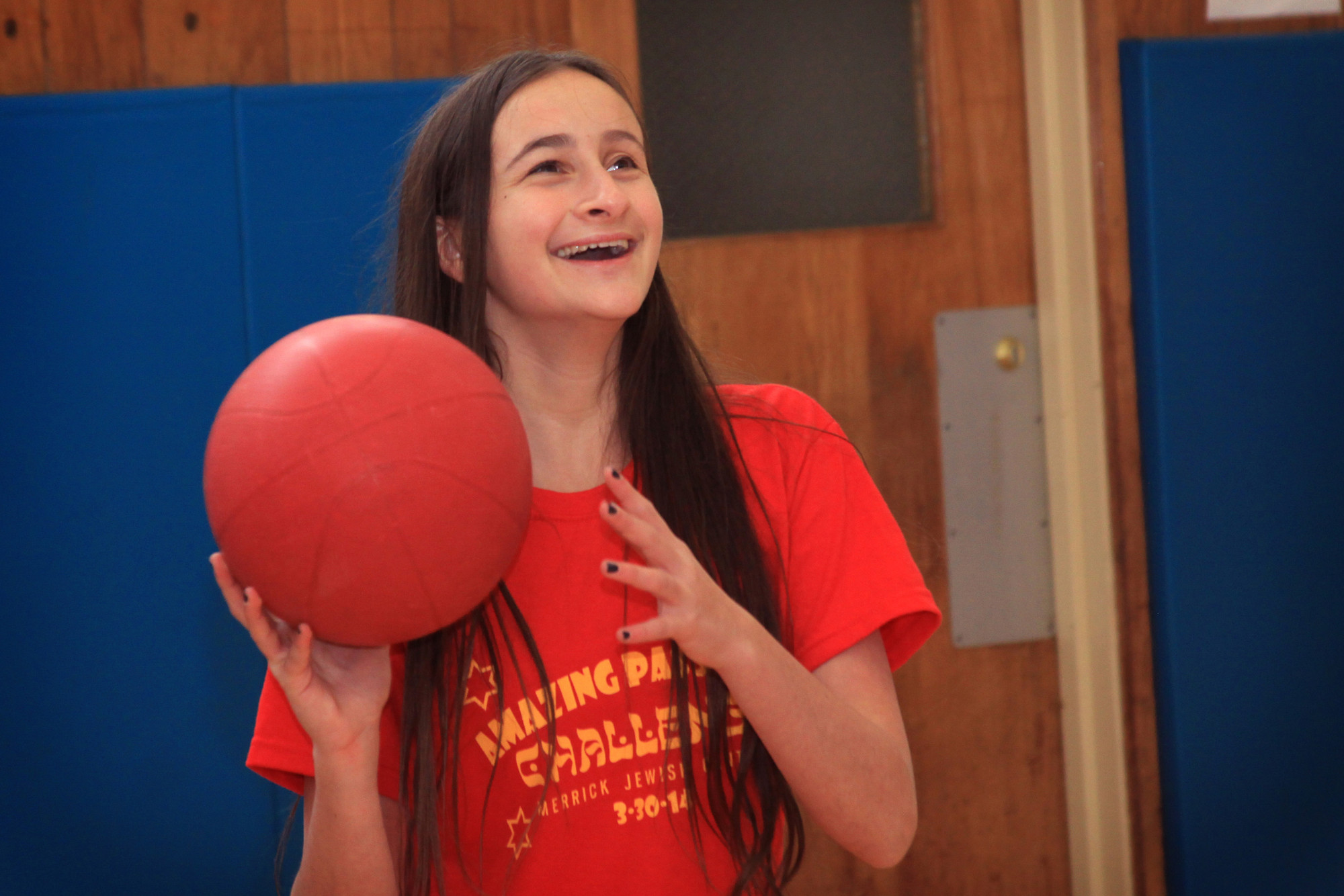 Andie Ofsink, 13, competed in a basketball shooting competition at Levy-Lakeside Elementary School during the challenge.