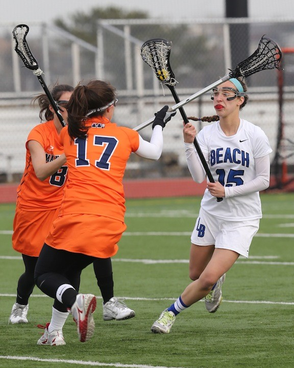 Melissa Rubin, right, a four-year varsity player and a key to Long Beach's midfield, looked to avoid a pair of Manhasset defenders April 3.