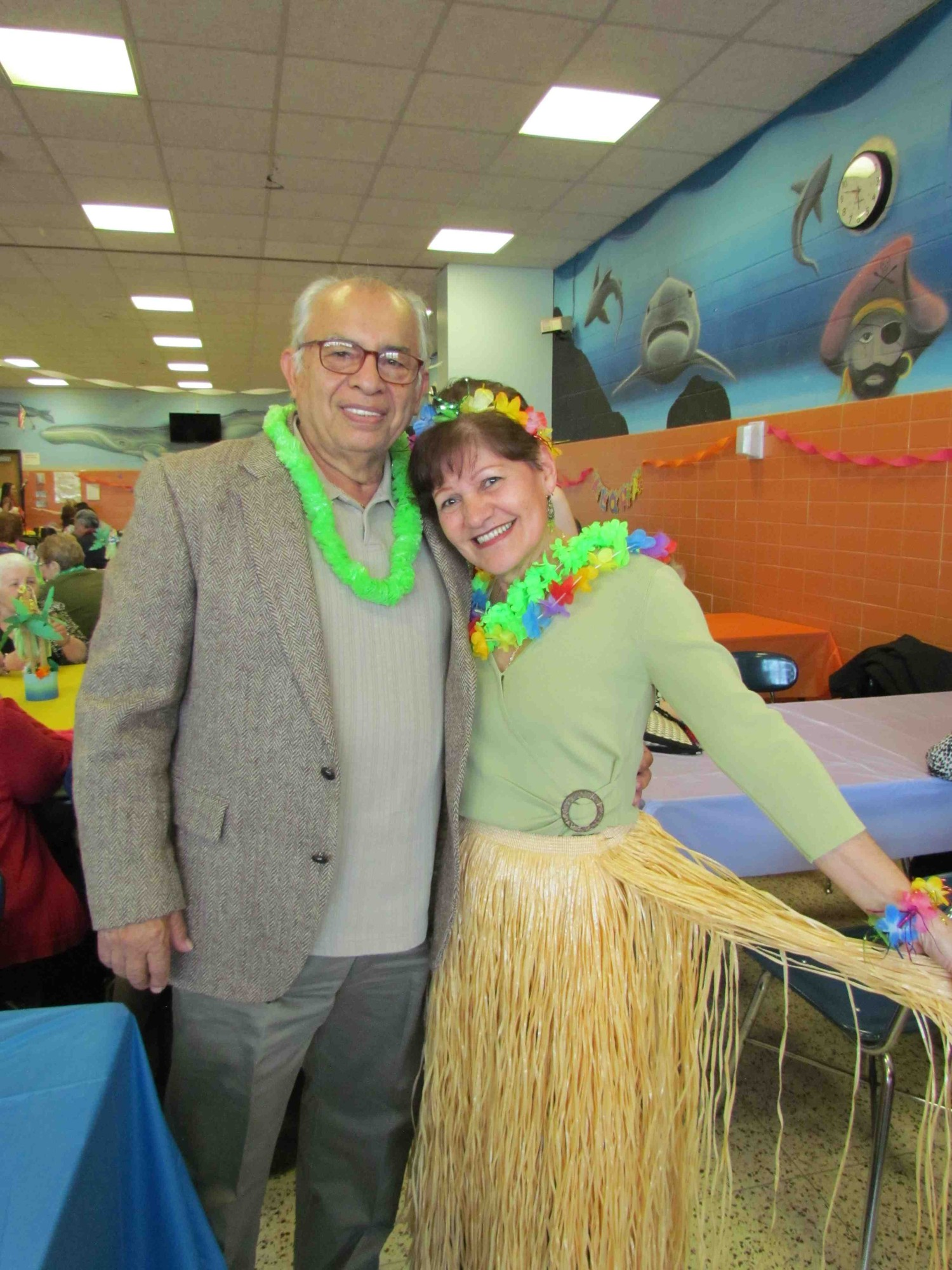 Mike and Rae Guzman of Bellmore dressed according to the Hawaiian theme at the annual senior citizens prom at Mepham High School on April 2.