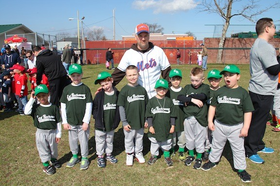 The Green Team lining up to take a photo at the East Rockaway Little League April 5th