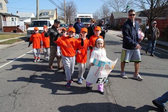 Players, coaches and families marched in the East Rockaway Little League Parade on  April 5.