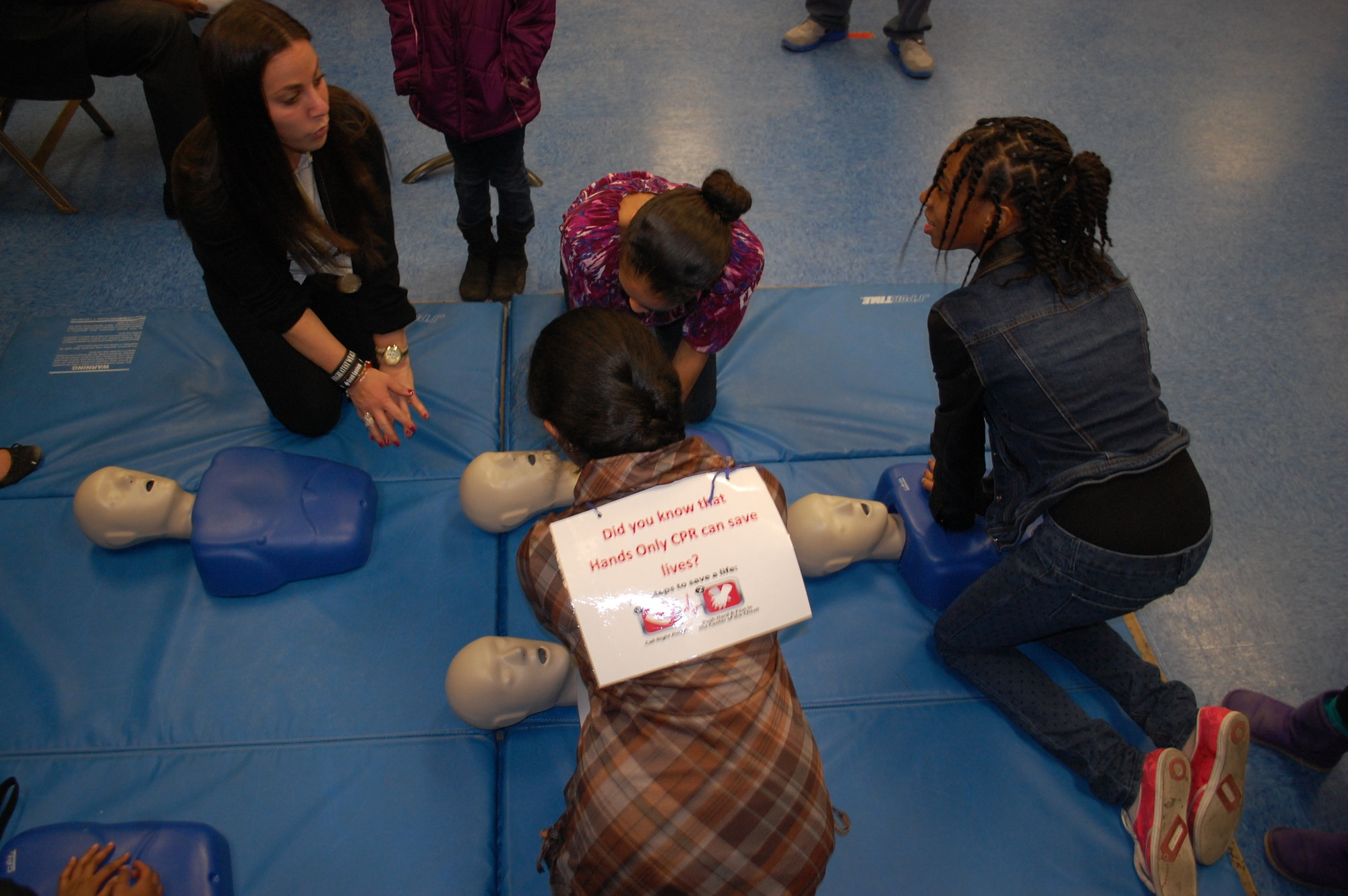 District 30 Quest teacher Ilissa Epstein, left, gave CPR demonstrations to students and community members at Memorial Junior High School.