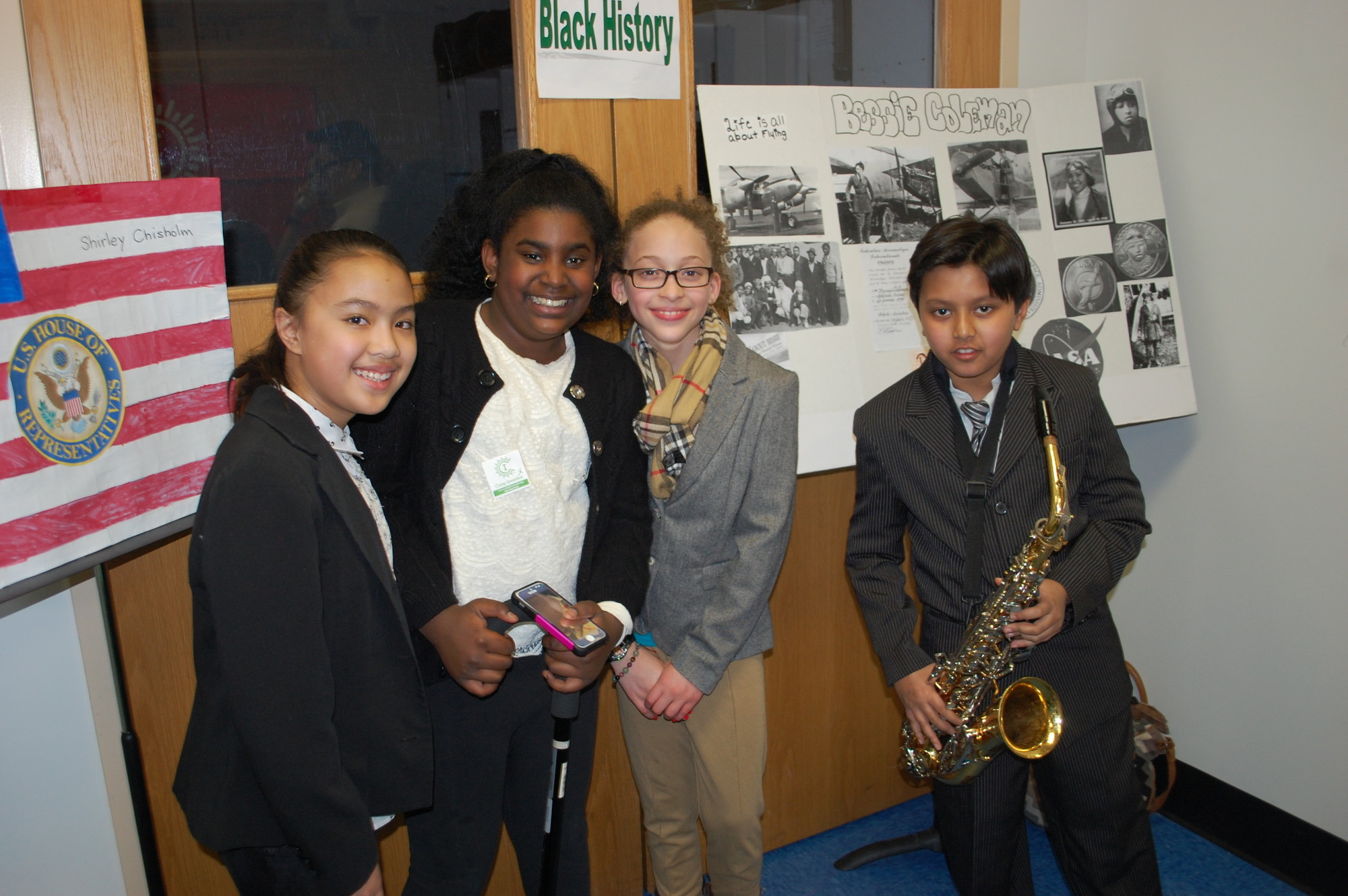 Forest Road School fifth-graders, from left, Kristin Luyun, Tercella King, Alyssa Goodleigh and Ritik Jain, shared their Black history projects.