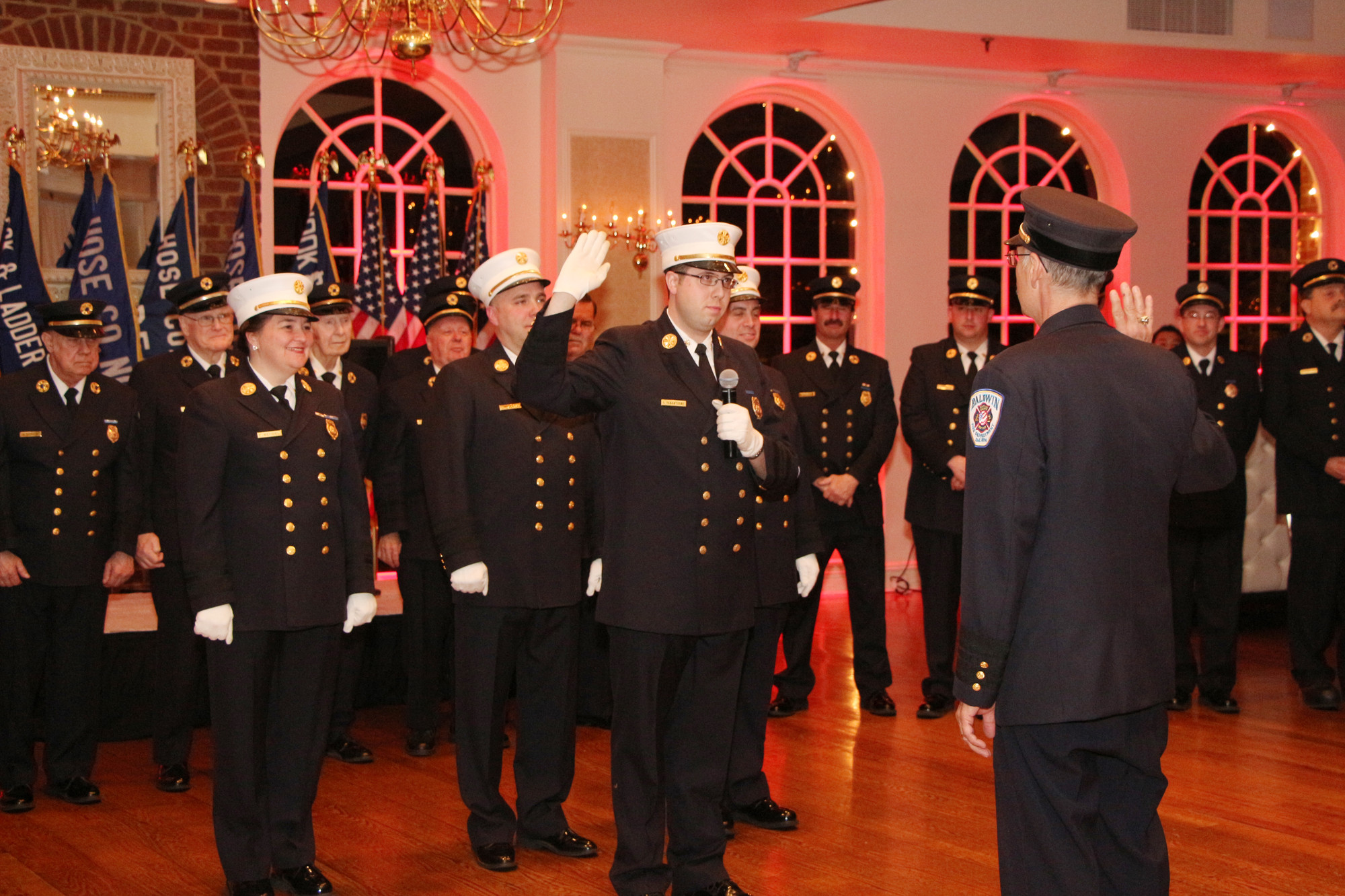 Ex-chief Paul A. Yanantuono, right, swore in his son Craig as chief of the Baldwin Fire Department on April 5.