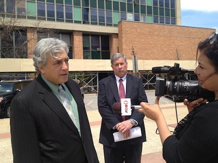Attorney Francis Mcquade, left, and former Assistant Corporation Counsel Ted Hommel at a press conference in front of City Hall last May.