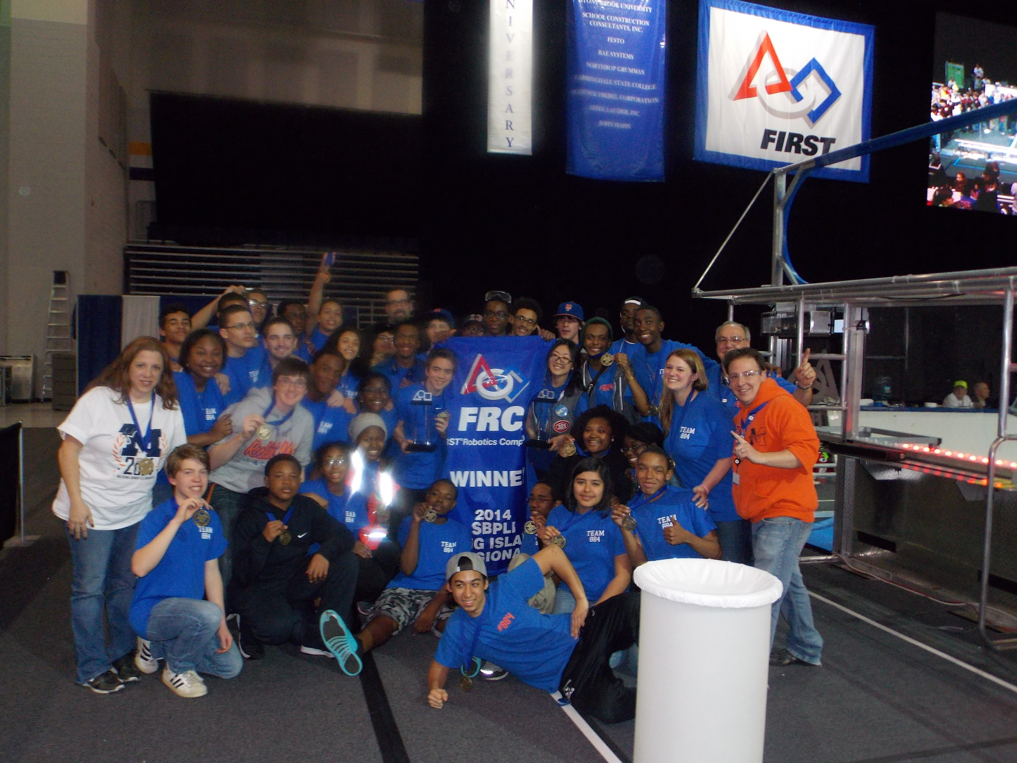 Malverne�s master teacher Charles Vessalico, right, celebrated a recent victory with his Mechanical Mules Robotics Team after qualifying for the quarter finals at this year�s FIRST robotics regional competition.