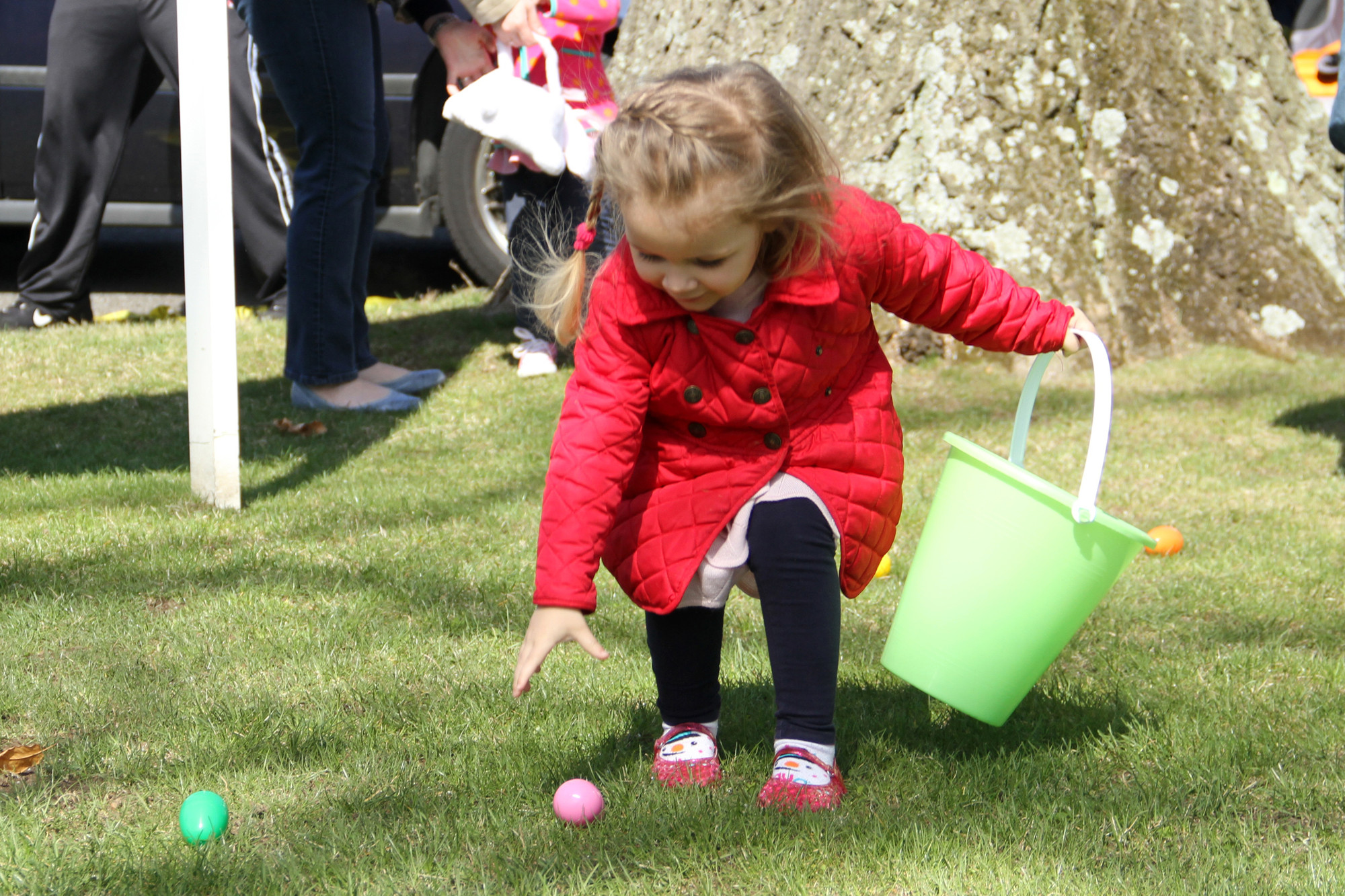 Three-year-old Ella Connor nabbed one of many colorful finds at the Malverne Merchants and Professional Association�s Easter Egg Hunt at Gazebo Park on April 19.