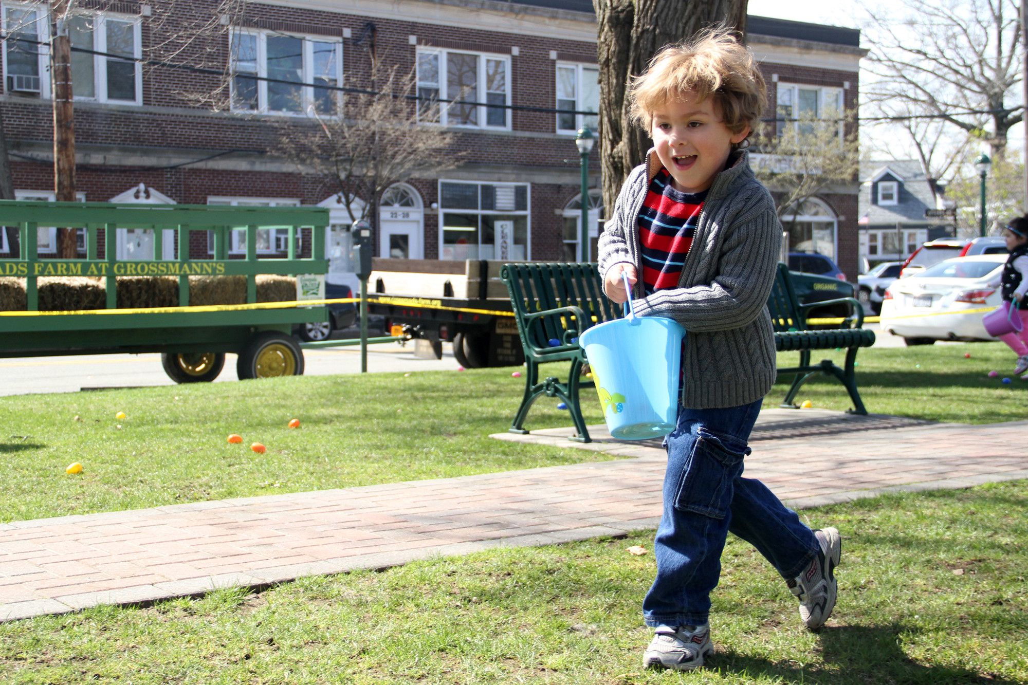 James Gorra dashed across the field at Gazebo Park to fill his bucket with as many eggs as he could find at this year�s event.