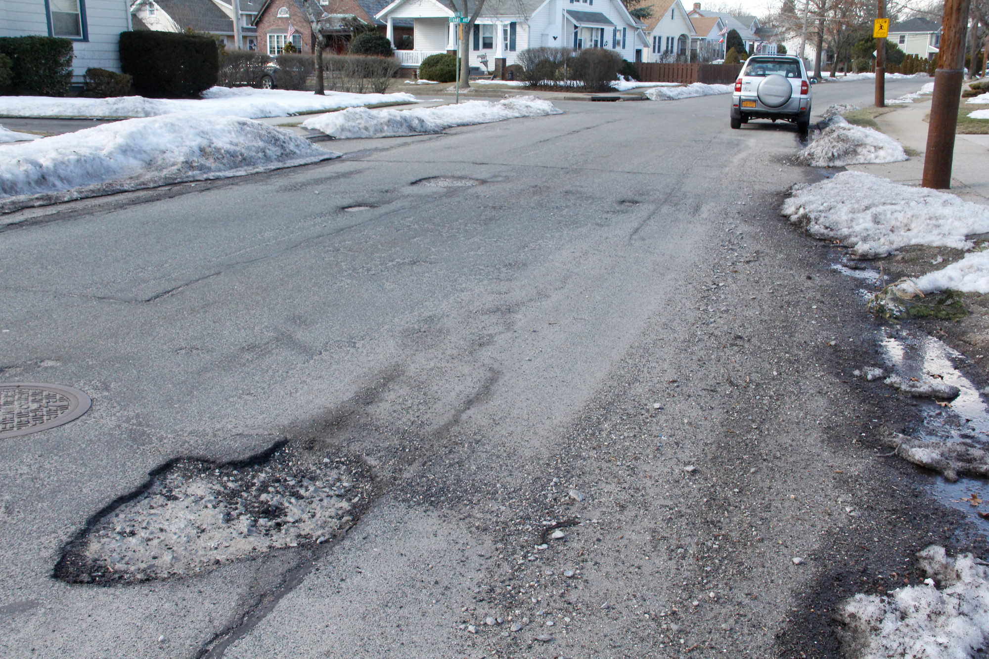 Potholes still remain four months after this year's winter and road crews continue to repair holes.