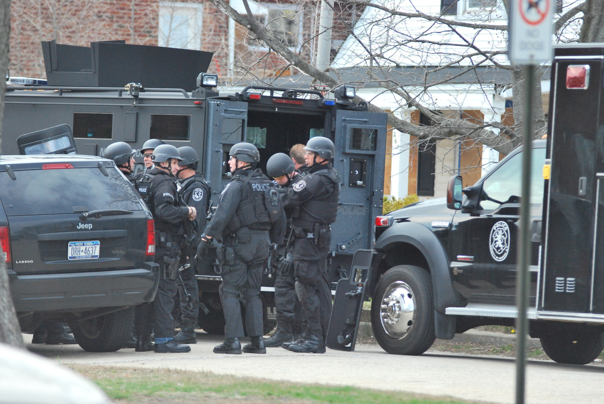 A Nassau County Police Department SWAT team entered a home on Laurelton Boulevard Tuesday after a false 911 call was made to police claiming that a teenager had shot his mother and brother.