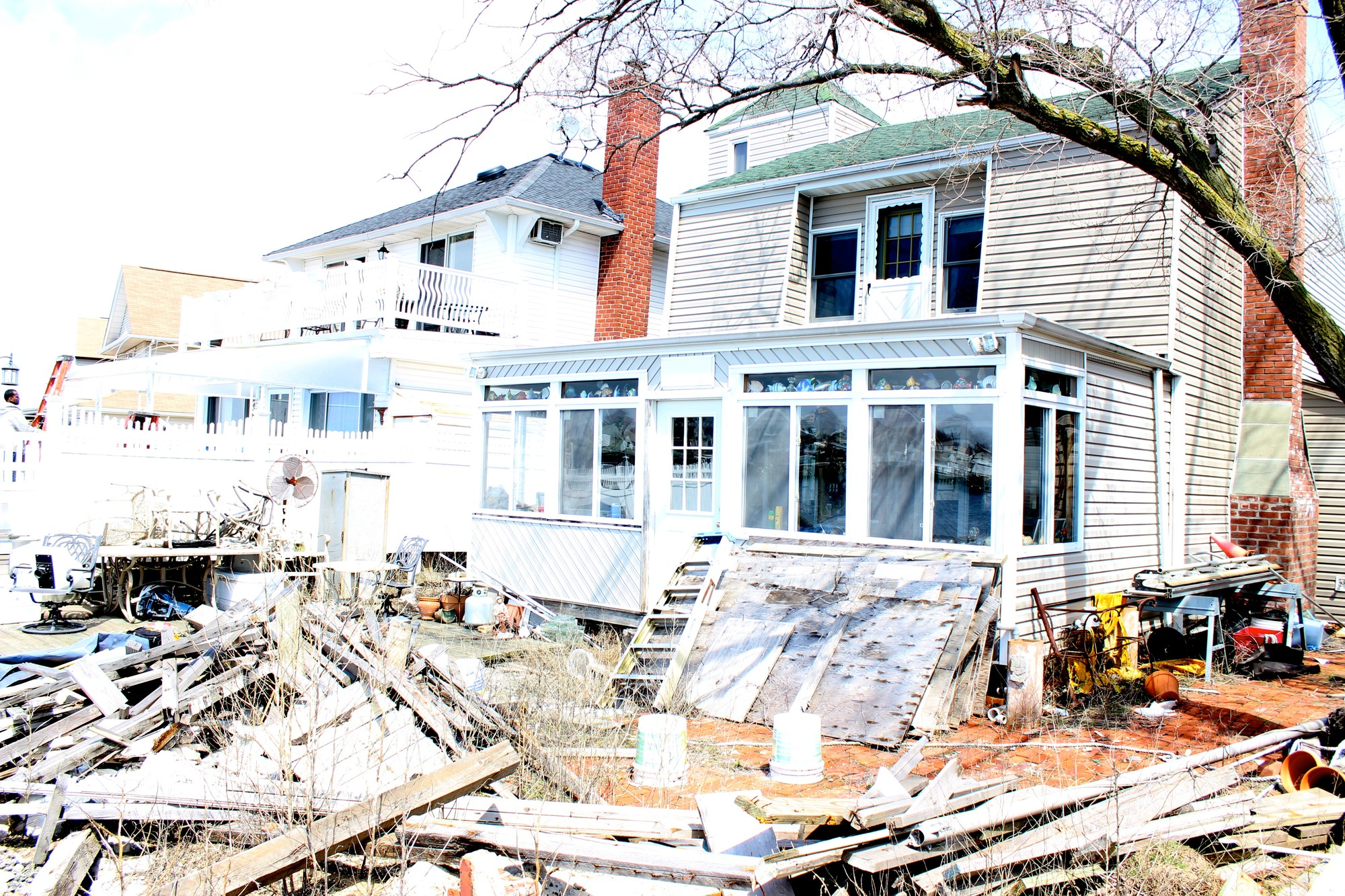 The bulkhead and deck behind Meadowmere Park resident Frank Zerbe's house has yet to be fully repaired.