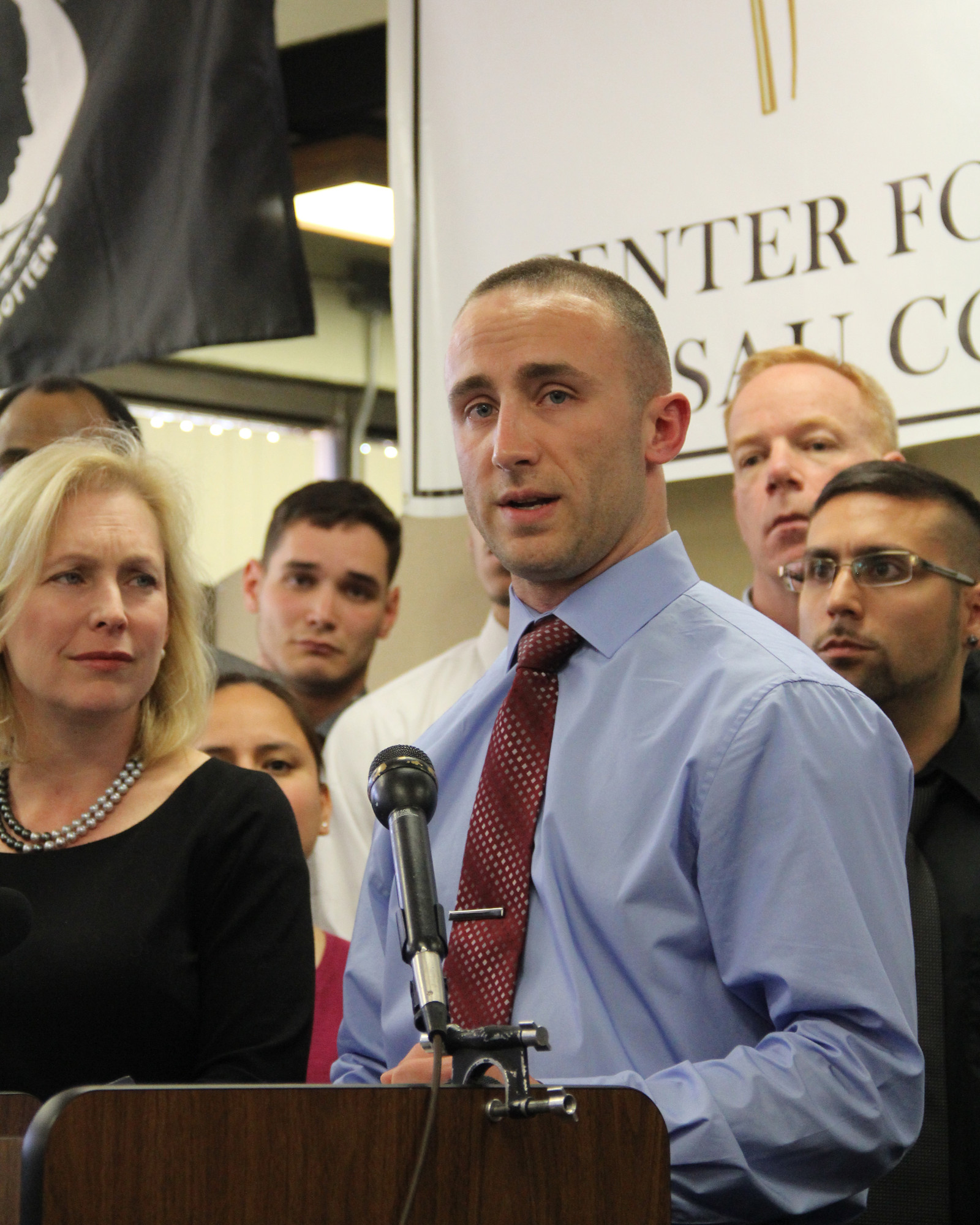 Iraq War veteran Kristofer Goldsmith, 28, detailed his discharge experience at a news conference on April 16, as Sen. Kirsten Gillibrand, left, listened.
