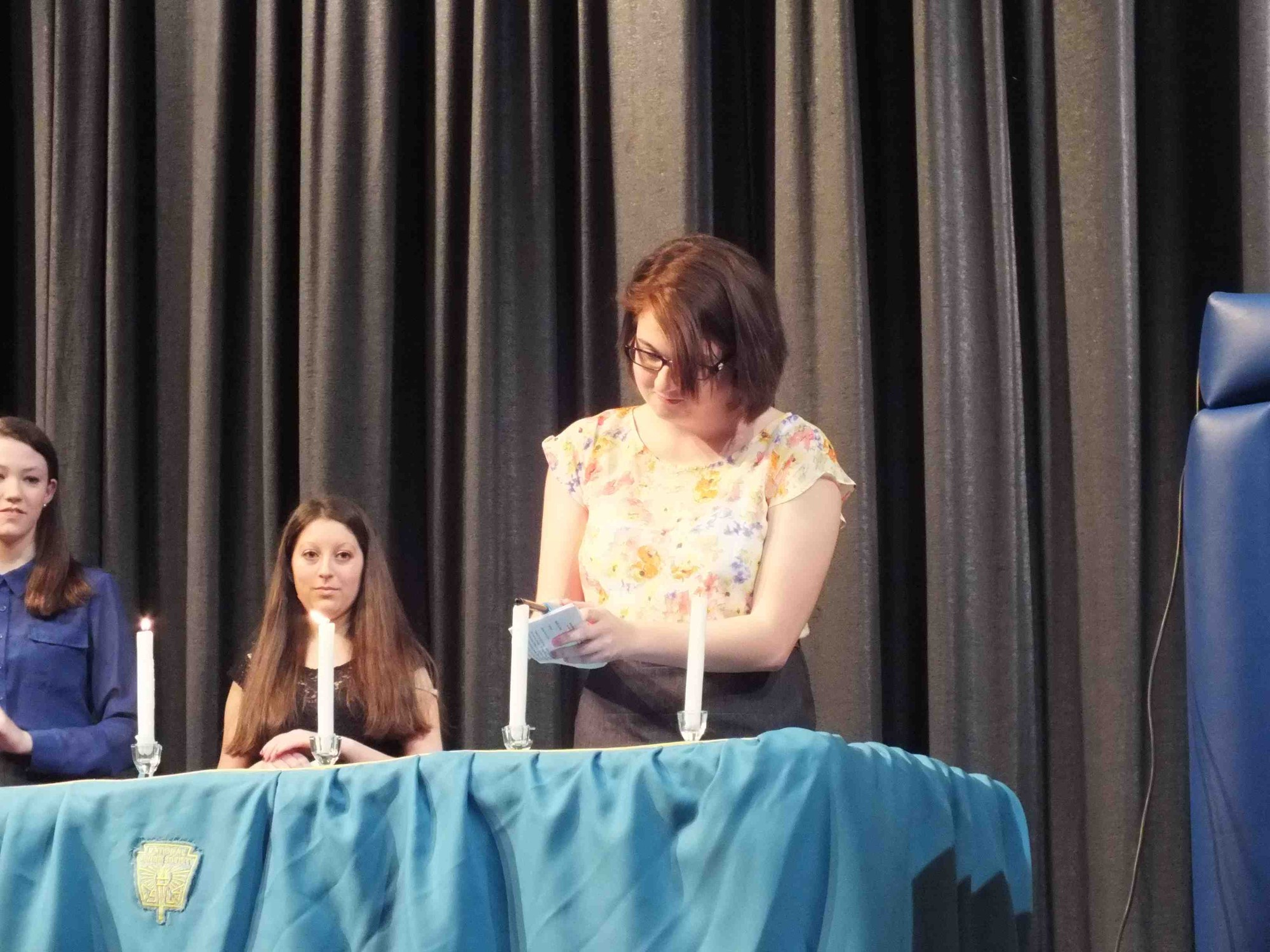 Sarah Bilello took part in the candle-lighting ceremony at the Calhoun High School National Honor Society induction ceremony.