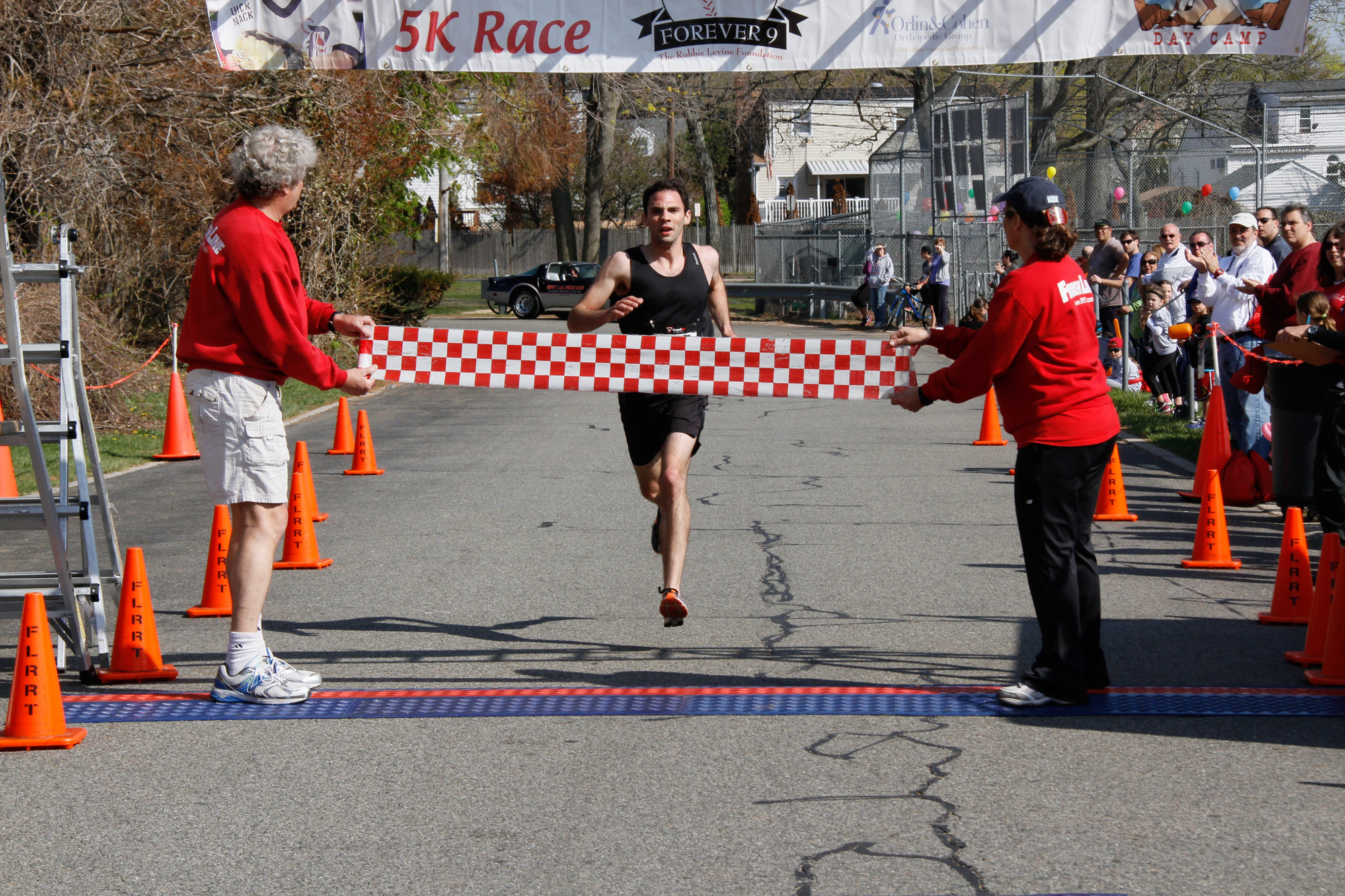 The ninth annual Robbie's Run will be held this Sunday. Above, Sean Mahon, of Merrick, finished first in the 2013 Robbie's Run 5K.