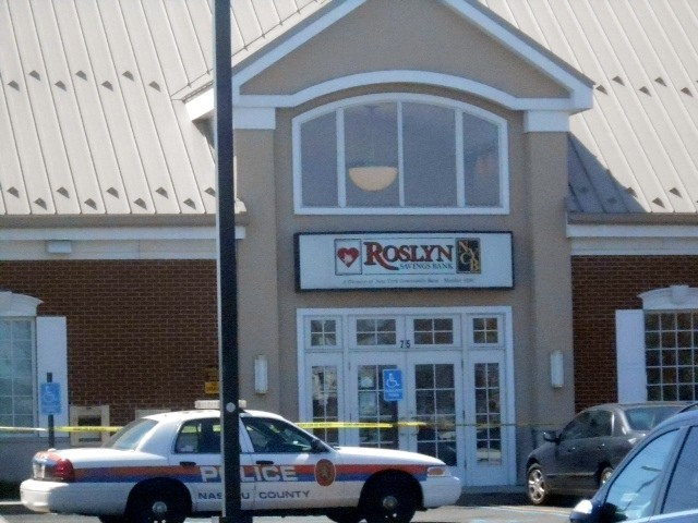 Police are seeking a lone suspect who they say robbed this Roslyn Savings Bank in Valley Stream on Thursday, Apr. 24.