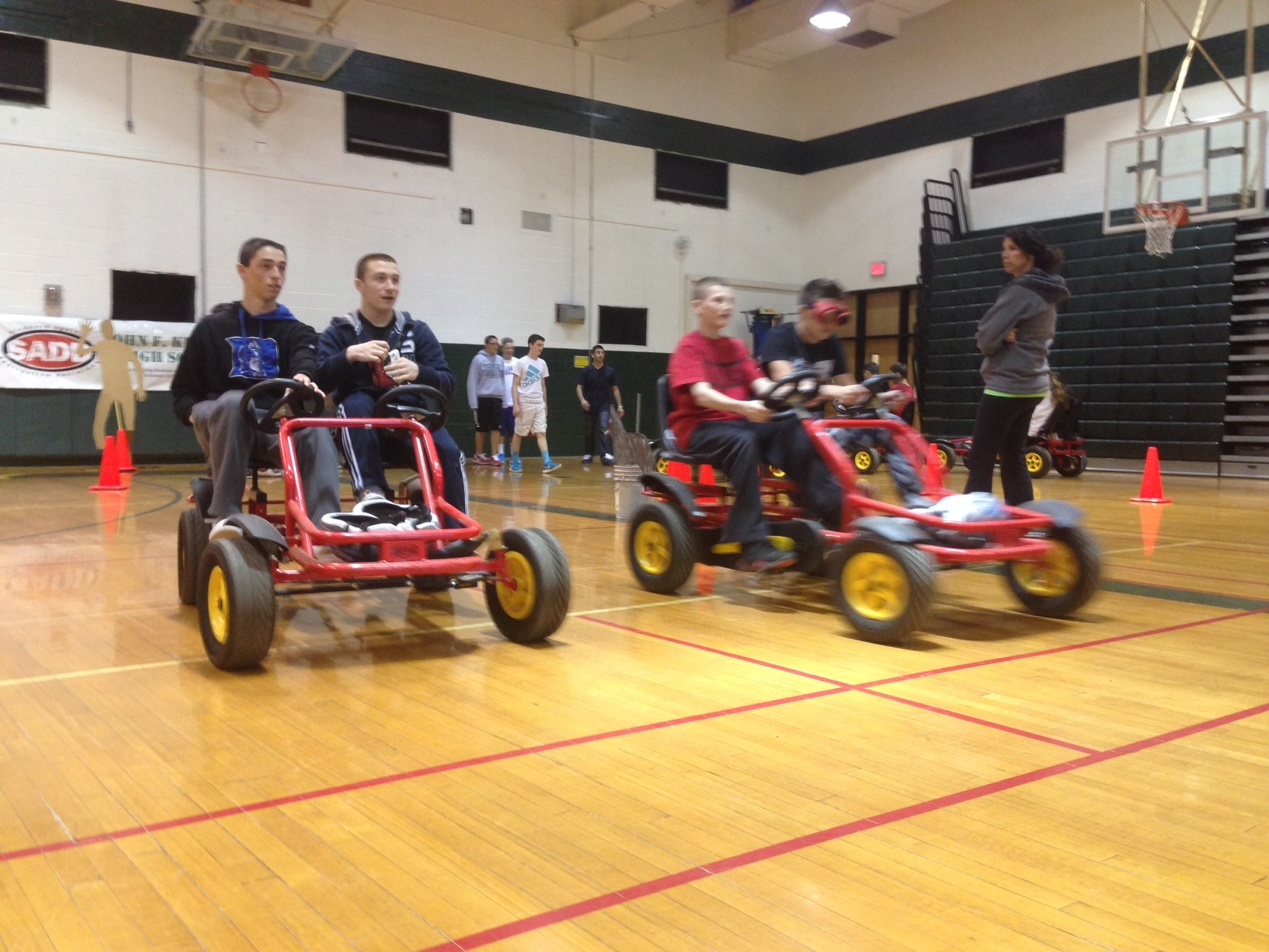 With special goggles that mimic the effects of DWI, Kennedy High School students rode pedal cars around their gymnasium last week during a SADD club DWI and distracted driving awareness event.