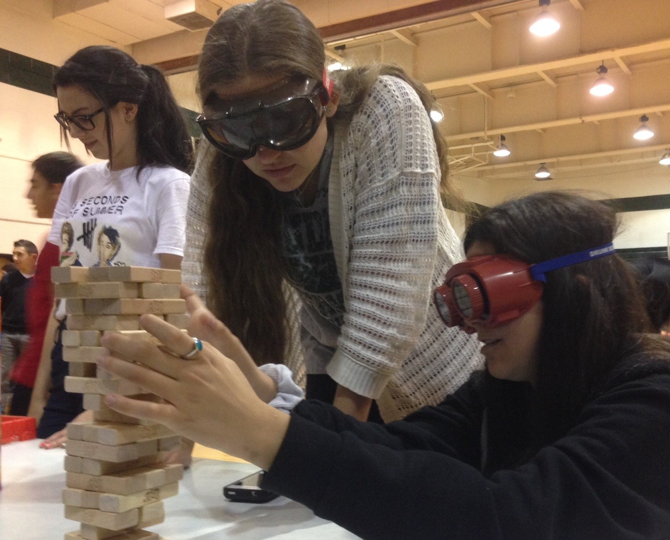 Tenth-graders Mikayla Leef and Cara Slovinsky tried to stack blocks while wearing the goggles.