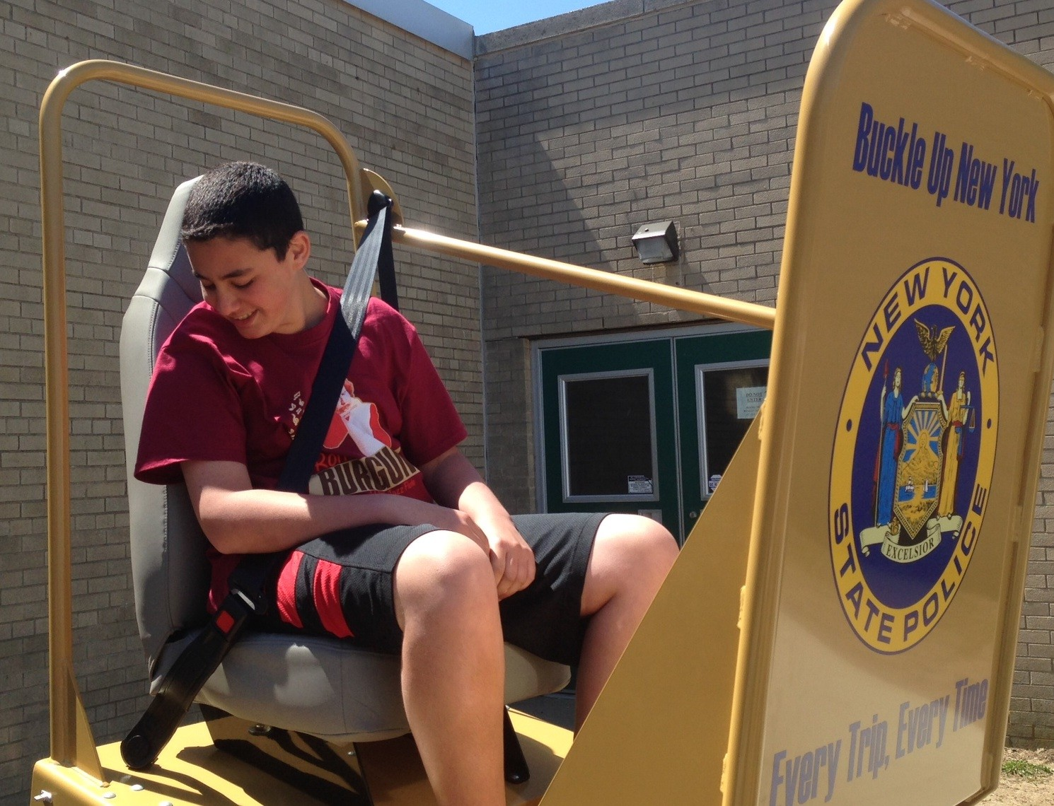 Ninth-grader Noah Tepper prepared to take the plunge on the New York State Police Department's Seat Belt Convincer.