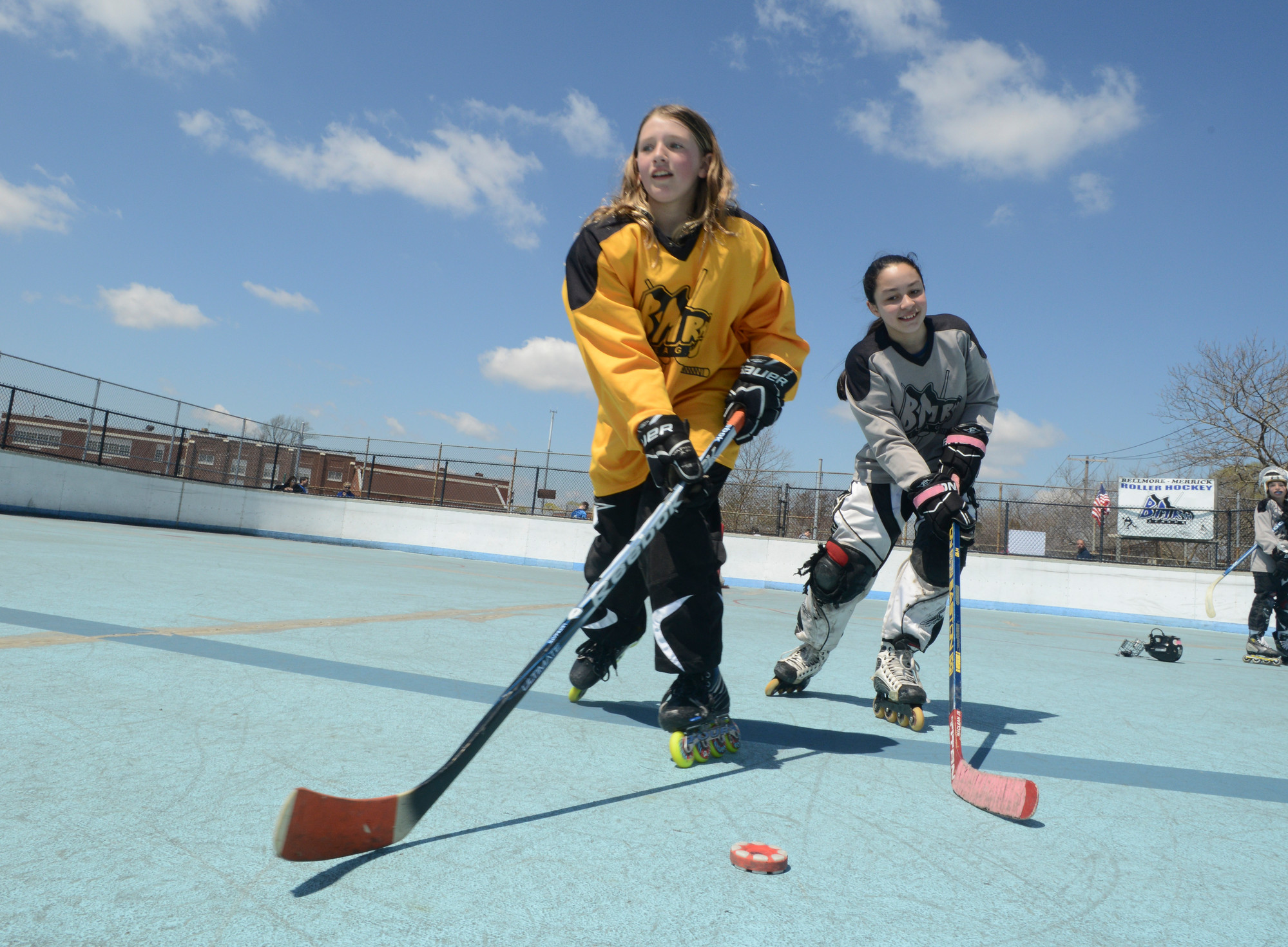 Julia Cole, 11, and Molly Quan, 10, laced up their inline skates on Saturday during the Bellmore-Merrick Roller Hockey League�s Player Appreciation Day.
