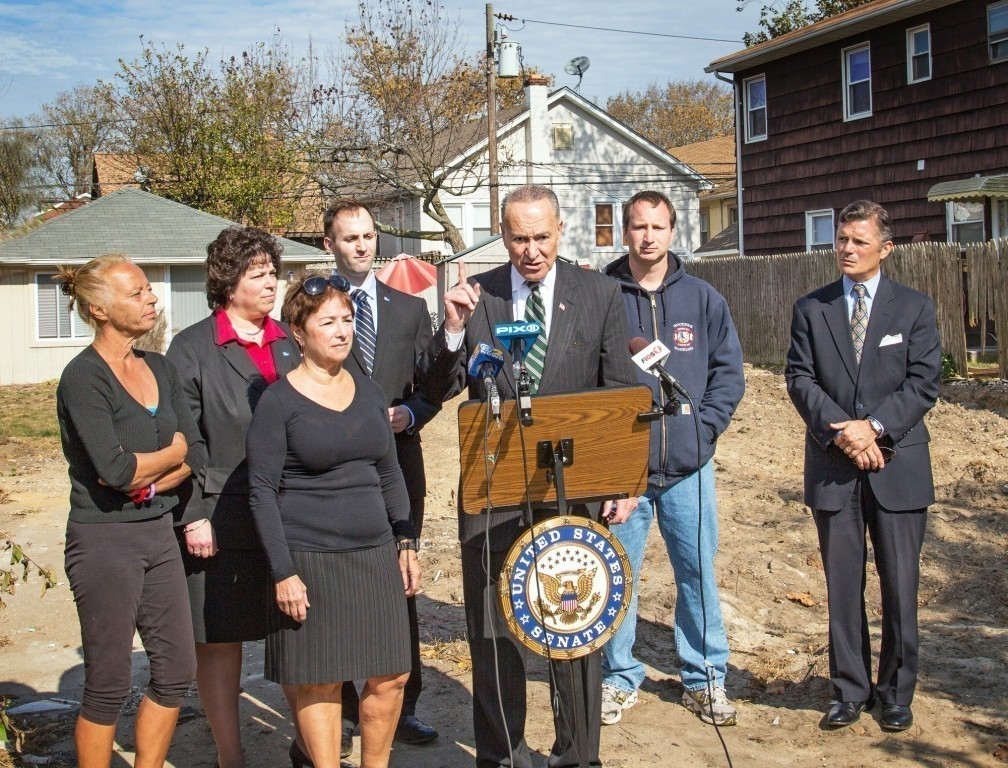 Senator Charles Schumer held a press conference at the vacant East Hudson Street property of Rena Bonne last October, where he urged FEMA to extend its statute of limitations for homeowners to file lawsuits against their flood insurance companies