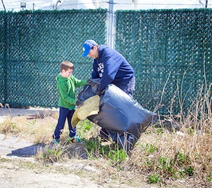 Maceo, 8, left, and his dad, City Councilman Anthony Eramo, collected trash together.